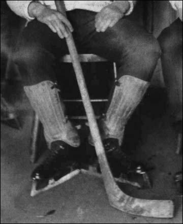 Short Shin Pads and a Round Handle Stick 1890